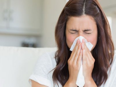 a woman with cold and flu